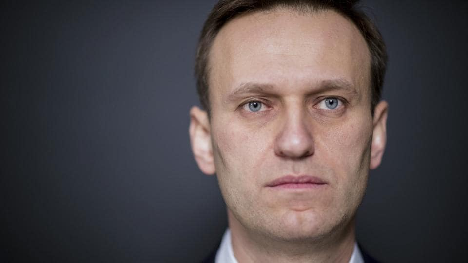 Russian opposition leader Alexei Navalny listens at the Russia's Central Election commission in Moscow, Russia.