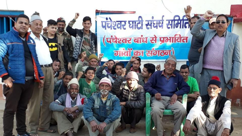 Villagers, demanding fertile land in lieu of their acquired land, stage protest at Panku village.