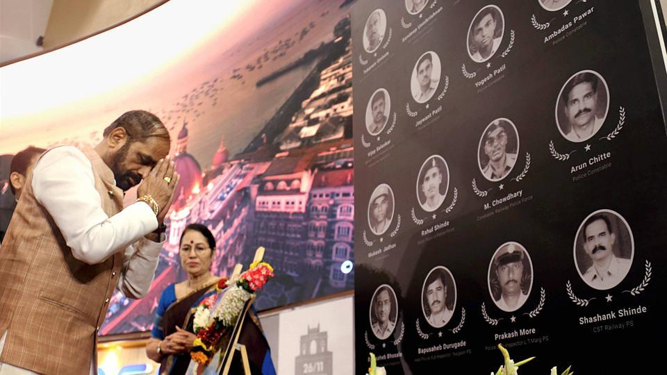 Union minister Hansraj Ahir pays tributes to the martyrs of 26/11 terror attacks on the anniversary of the gruesome incident, in Mumbai.
