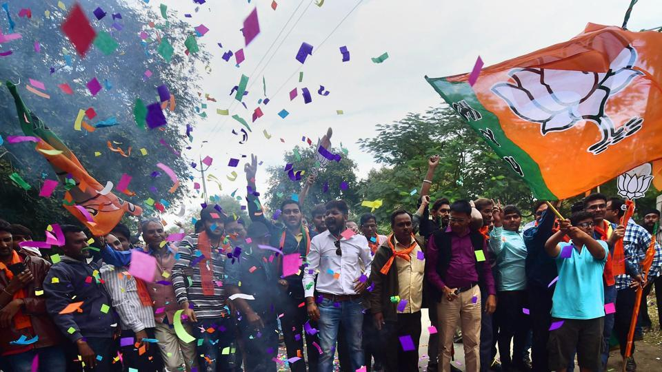 BJP supporters burst firecrackers to celebrate the party's victory in Gujarat assembly elections in Gandhinagar.