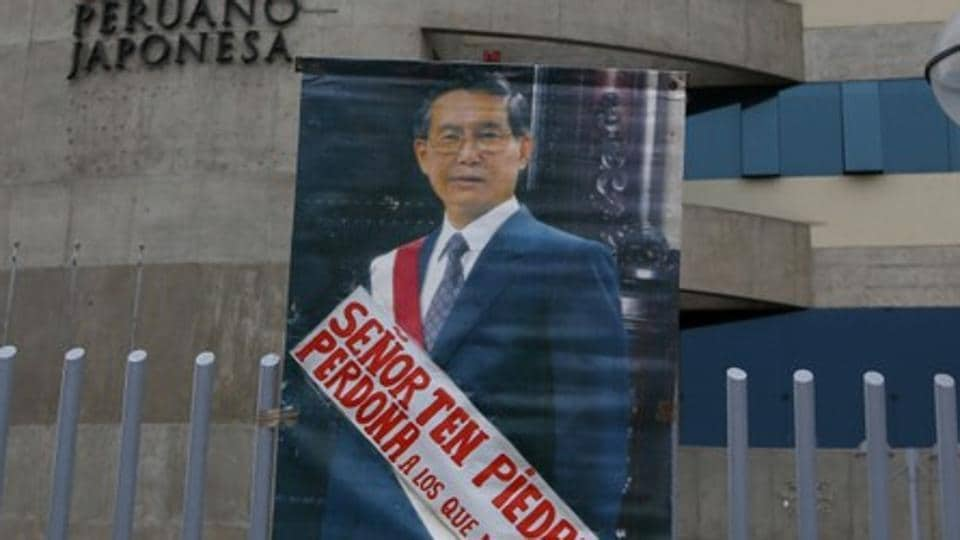 A picture of Peru's former President Alberto Fujimori who was serving a 25-year prison sentence is seen outside Centenario hospital after President Pedro Pablo Kuczynski pardoned him, in Lima, Peru, December 25.