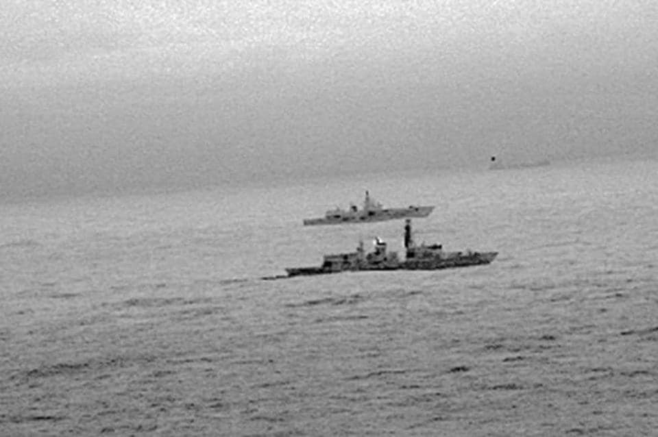 Images from an infrared camera on a helicopter show Royal Navy frigate HMS St Albans escorting Russian warship Admiral Gorshkov as it passes close to UK territorial waters.