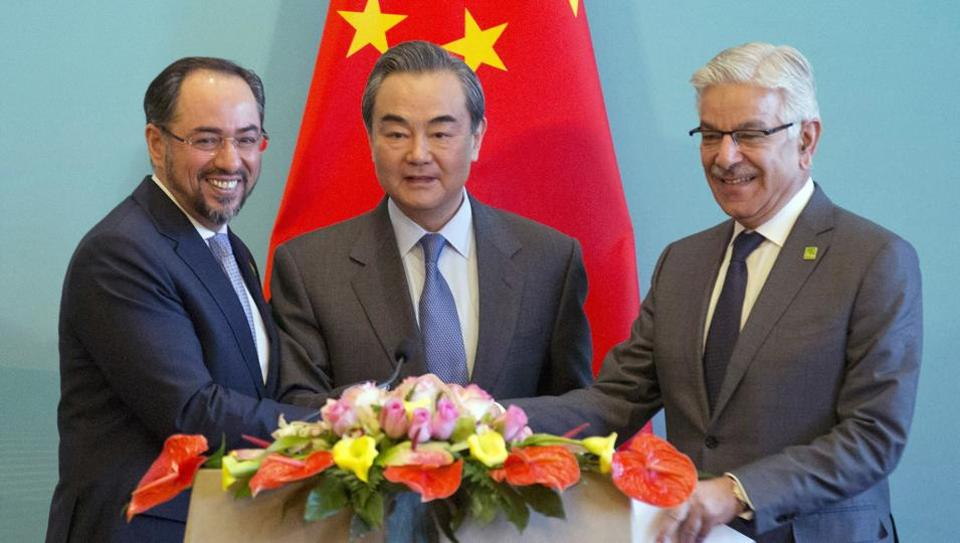 (From left) Afghanistan foreign minister Salahuddin Rabbani, Chinese foreign minister Wang Yi and Pakistani foreign minister Khawaja Asif hold hands to pose for a photo after a press conference for the 1st China-Afghanistan-Pakistan Foreign Ministers' Dialogue held in Beijing, China.