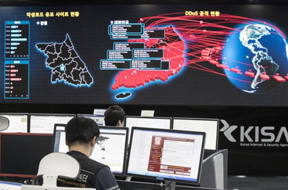 Employees watch electronic boards monitoring possible ransomware cyberattacks at the Korea Internet and Security Agency in Seoul, South Korea.