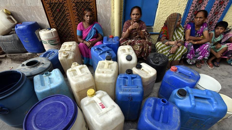 Women waiting with cans for a water tanker in Delhi's East Patel Nagar in May 2017.