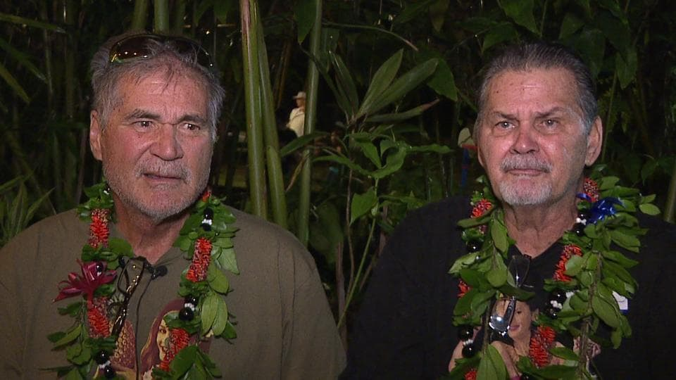 In this image from a video provided by Honolulu news station KHON, Alan Robinson and Walter Macfarlane are interviewed in Honolulu. The two Hawaii men grew up as best friends and recently learned that they are actually brothers.