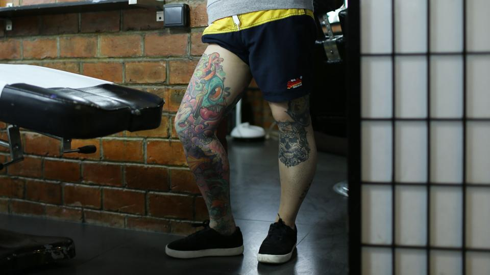 """Even now people are judging, they don't think that people should get big tattoos, especially women,"" said Zhuo, who has tattoos across both sides of her scalp. ""Still, people think it's more acceptable for men to get a tattoo than women and some get smaller ones to hide it from older family members or work,"" she added.  (AFP)"