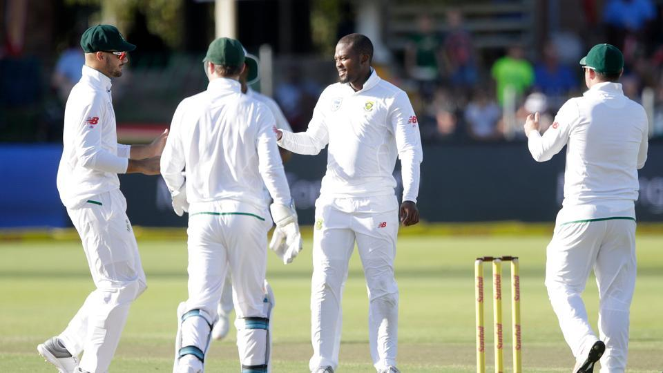 South African bowler Andile Phehlukwayo (2R) celebrates the dismissal of Zimbabwean batsman Peter Moor (not in picture) during the second day of the day-night Test cricket match between South Africa and Zimbabwe at St George's Park Cricket Ground in Port Elizabeth on December 27, 2017. Zimbabwe lost by an innings and 120 runs.