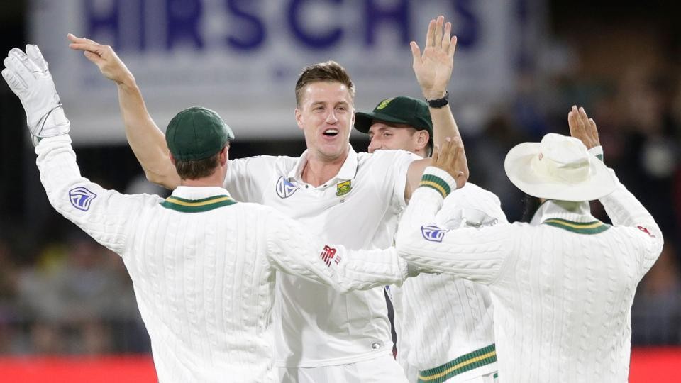 Morne Morkel (2L) picked three wickets on the first day of the day-night Test match at St. George's Park Cricket Ground in Port Elizabeth on December 26, 2017. Get full cricket score of South Africa vs Zimbabwe here.