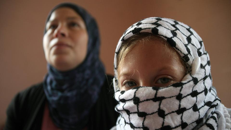 Nariman Tamimi (L) and her daughter Ahed get ready for a weekly demonstration against Israeli occupation in Nabi Saleh on August 31, 2012. As Palestinians continue protests against Donald Trump's decision to recognize Jerusalem as Israel's capital, the image of the teenage girl facing the Israeli army has captured imaginations, breaking the narrative of an intifada symbolized by tear gas canisters and rock pelting. (Abbas Momani / AFP File)