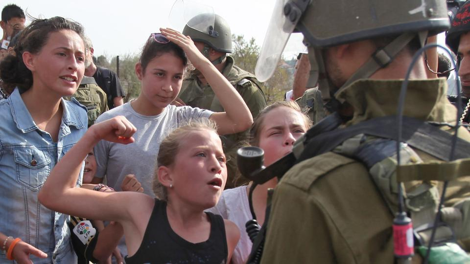 And in 2012, when she was 11, she was photographed raising her fist and yelling at another Israeli soldier — an action that earned her the Hanzala Courage Award award from Turkey and a meeting with Turkish President Recep Tayyip Erdogan. That her family appears to encourage these confrontations with Israeli soldiers offends some Palestinians and has enraged many Israelis. (Abbas Momani / AFP File)
