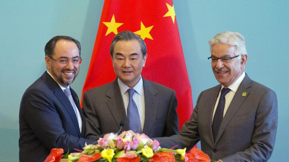 Afghan foreign minister Salahuddin Rabbani, Chinese foreign minister Wang Yi and Pakistani foreign minister Khawaja Asif attend a joint news conference after the 1st China-Afghanistan-Pakistan Foreign Ministers' Dialogue in China