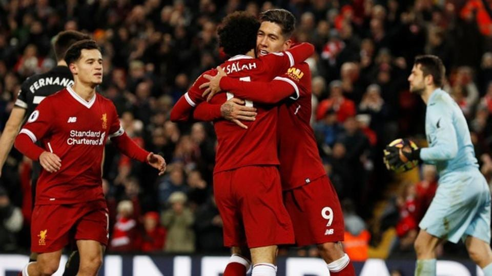 Roberto Firmino celebrates scoring one of his two goals against Swansea City in the Premier League on Tuesday.