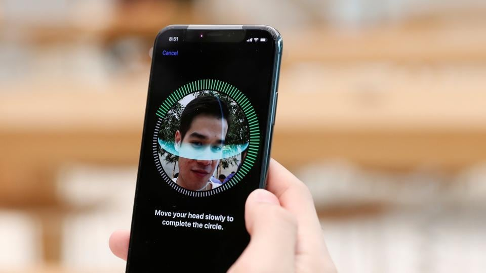 A customer sets up his iPhone X Face ID during its launch at the Apple store in Singapore November 3, 2017.