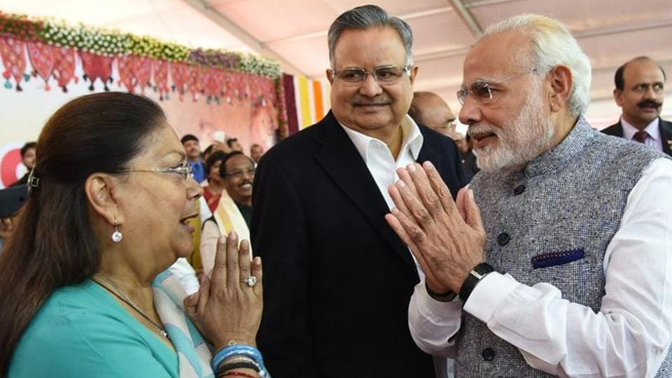 Chief minister Vasundhara Raje greets Prime Minister Narendra Modi at the swearing in ceremony of Vijay Rupani as Chief Minister of Gujarat on Tuesday.