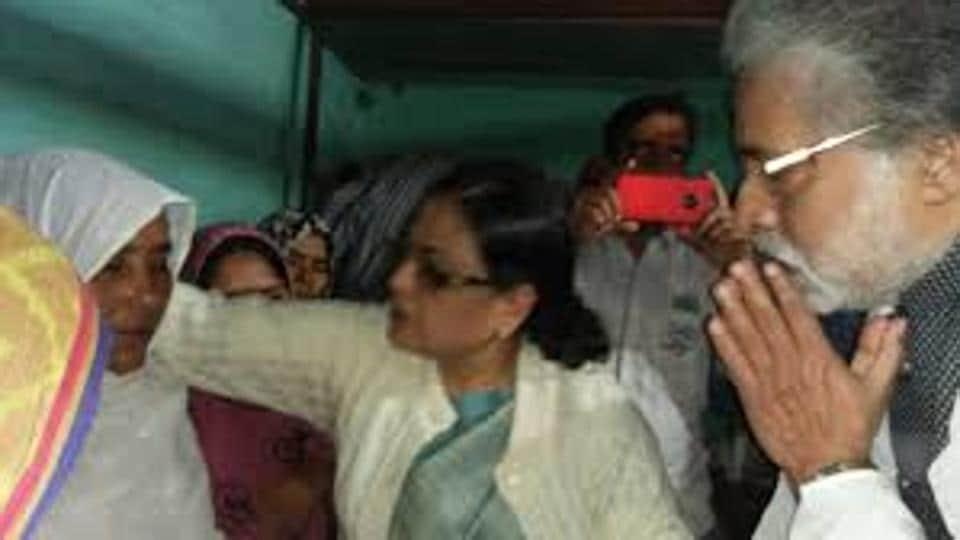 Trinamool Congress MPs Kakoli Ghosh Dastidar and Sudip Bandyopadhyay consoling the wife of Afrajul Khan at her residence in Malda.