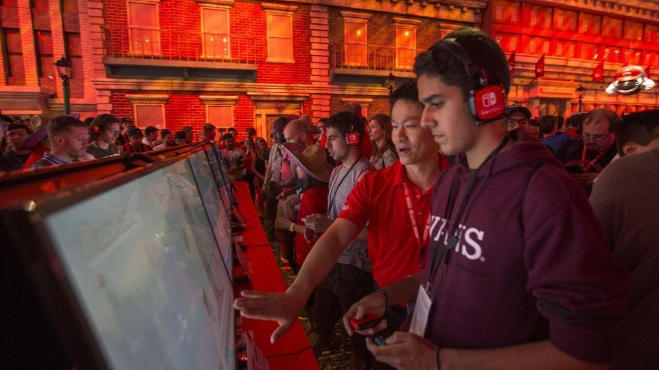 People game in the Nintendo exhibit on opening day of the Electronic Entertainment Expo (E3) at the Los Angeles Convention Center on June 13, 2017 in Los Angeles, California.