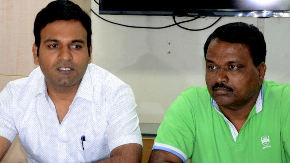 Ashwini Bidre's brother Anand and husband Raju Gore speak to the media on Thursday