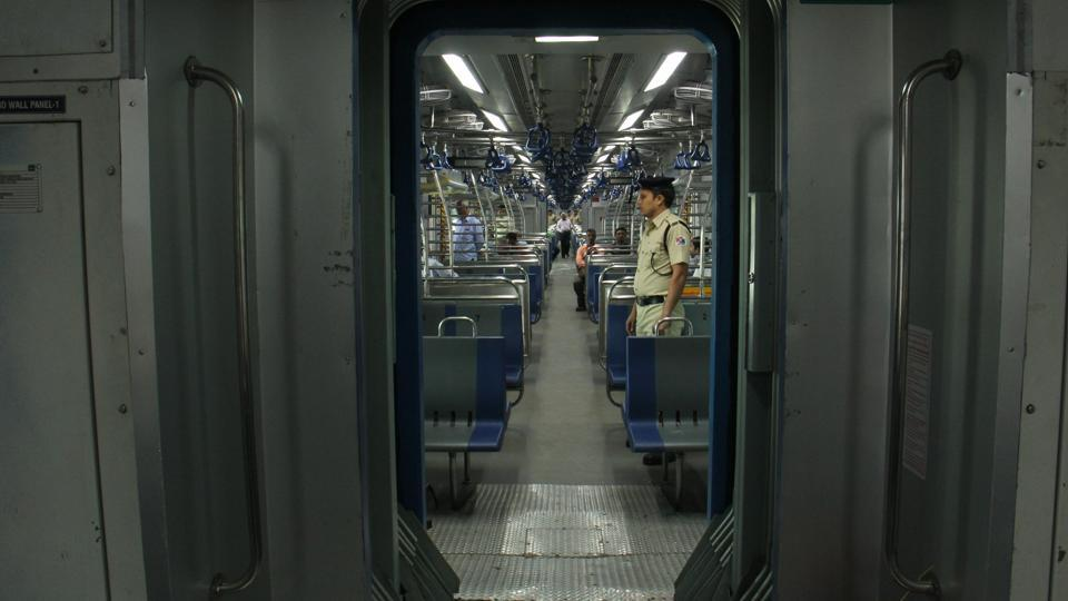 Commuters travel in the first AClocal train from Borivali to Churchgate in Mumbai on December 25.