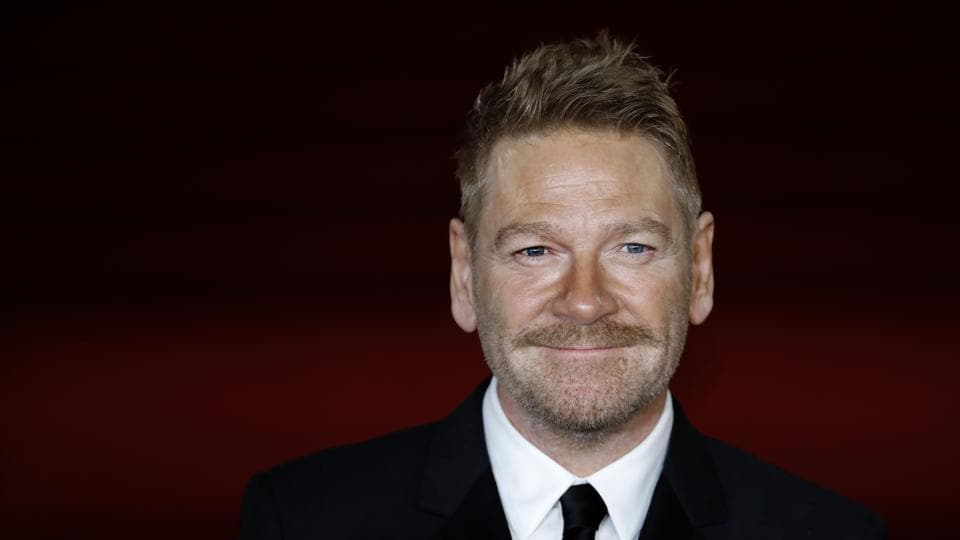 British actor, director, producer Kenneth Branagh poses upon arrival to attend the world premiere of the film Murder on the Orient Express at the Royal Albert Hall in west London.