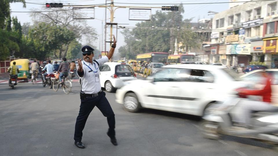 Traffic policeman Ranjeet Singh directs traffic while