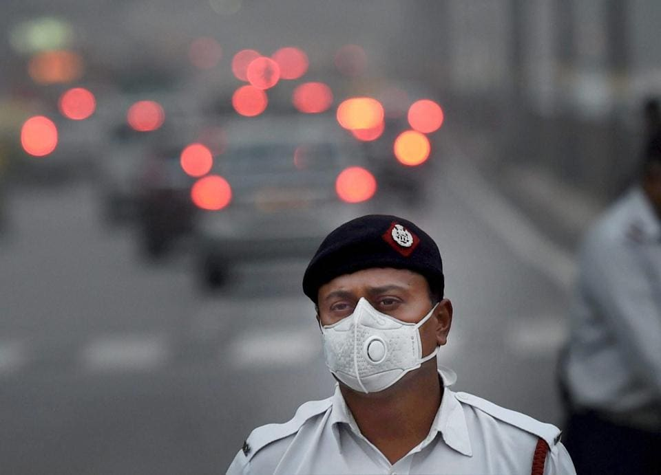 A traffic policeman wears an anti-pollution mask to protect himself from growing level of air pollution, in New Delhi on Tuesday, Nov 7, 2017.