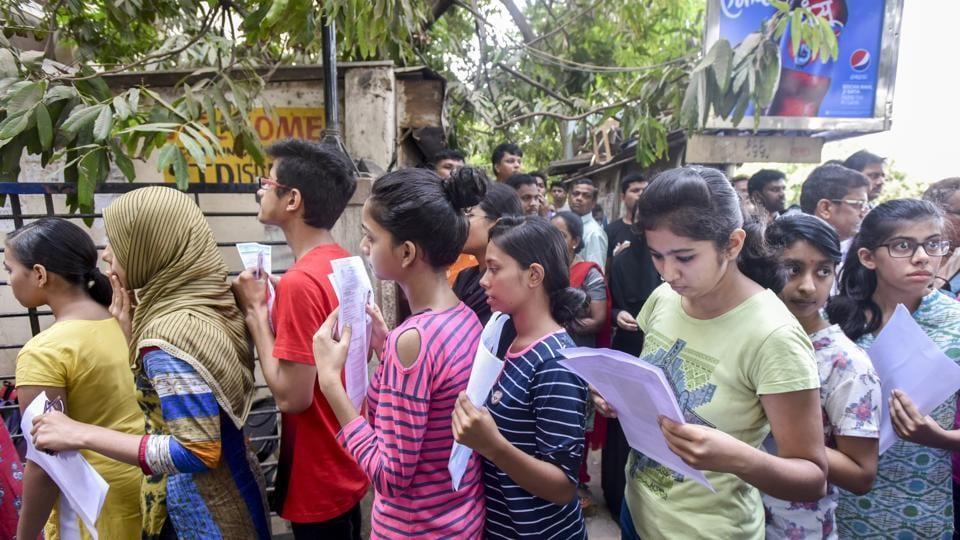 Students enter examination centre to appear for NEET exam in Mumbai.