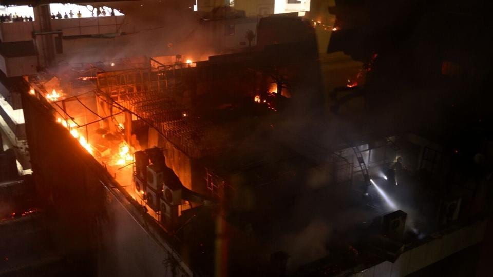 At least 14 people died and several were injured when a major fire broke out at a building in Kamala Mills Compound in Lower Parel late on Thursday night. The fire started after 12:30am on the third floor of the building on Senapati Bapat Marg, a commercial hub of the city, a police official said. (ANSHUMAN POYREKAR/HT PHOTO)