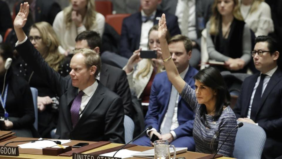 Matthew Rycroft (L), Britain's Ambassador to the UN and US Ambassador Nikki Haley vote in favour of a resolution, on December 22, 2017 proposing new sanctions against North Korea, including sharply lower limits on its refined oil imports, the return home of all North Koreans working overseas within 12 months, and a crackdown on the country's shipping. (Mark Lennihan / AP)