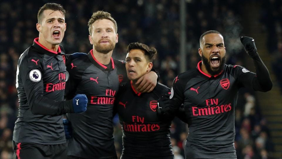 Alexis Sanchez celebrates with his teammates after Arsenal's victory over Crystal Palace in their Premier League encounter.