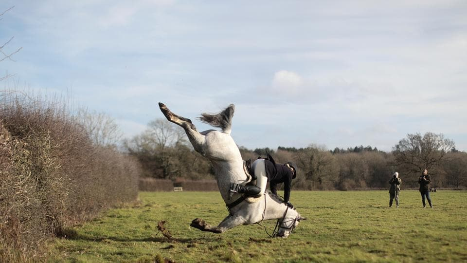 A member of the Old Surrey Burstow and West Kent Hunt crashes as she jumps a fence during the annual Boxing Day hunt in Chiddingstone, Britain on December 26, 2017. (Simon Dawson / REUTERS)