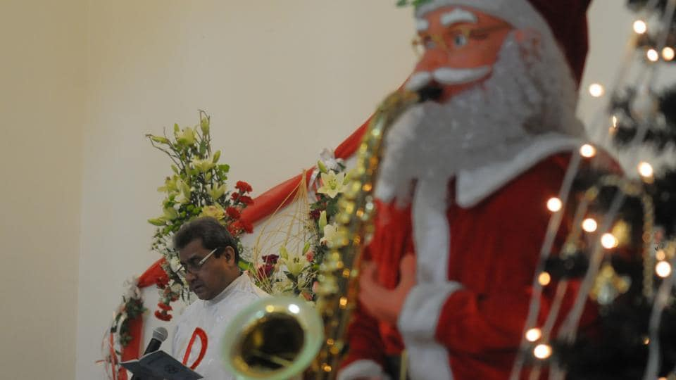 People participate  in prayers at the Church of the Epiphany, Gurgaon,  on December 25.
