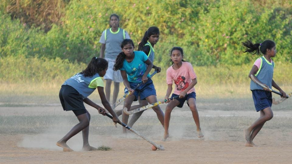 Hockey enthusiasts from Hesal village play a village-level match in Khunti  in Jharkhand.