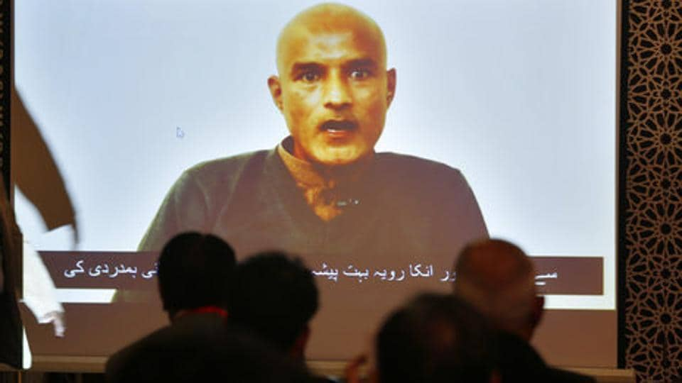 Pakistani journalists watch a video message of imprisoned Indian naval officer Kulbhushan Jadhav during a press conference by foreign ministry spokesman Mohammad Faisal, Islamabad, December 25, 2017