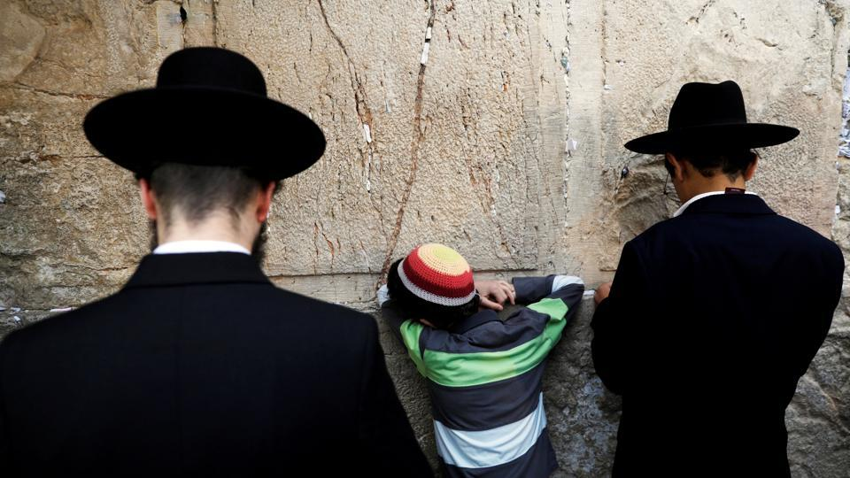 Hasidic Jews attend a special prayer for rain at the Western Wall in Jerusalem's Old City on December 28, 2017. (Ronen Zvulun / REUTERS)