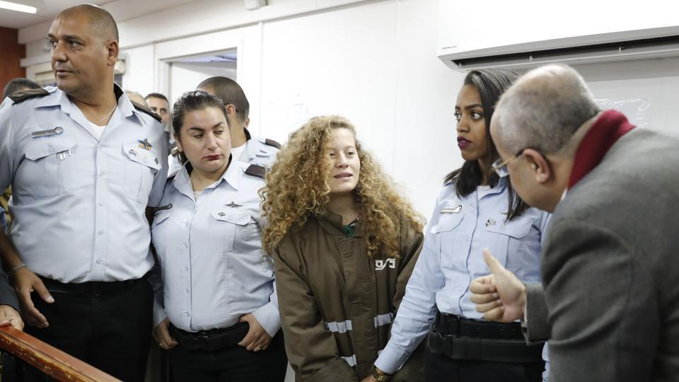 Palestinian Ahed Tamimi (C), 17-year-old campaigner against Israeli occupation, appears at a military court at the Ofer prison in the West Bank on December 28, 2017. Ahed is only a teenager, but has repeatedly been at the centre of the seemingly endless propaganda war between Israelis and Palestinians, with a video of her slapping soldiers the latest example. (Ahmad Gharabli / AFP)