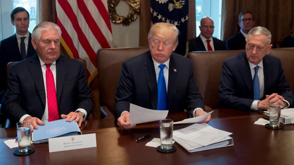 US President Donald Trump holds a cabinet meeting alongside Secretary of State Rex Tillerson (left) and Secretary of Defense Jim Mattis (right) at the White House.