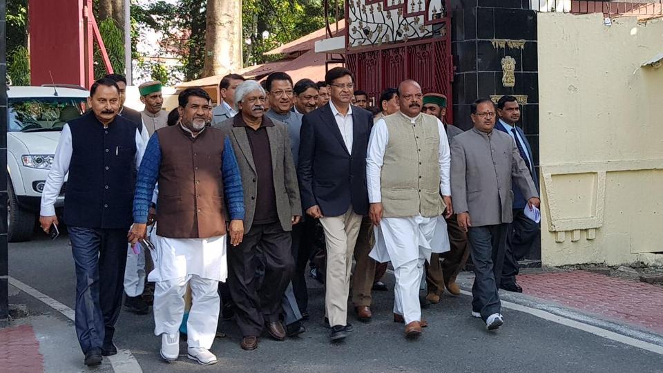 Congress state president PritamSingh leads a Congress delegation to the Raj Bhavan in Dehradun on Saturday.