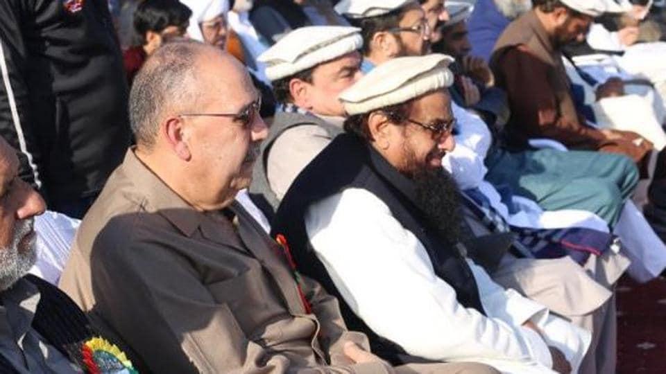 Palestinian ambassador Walid Abu Ali sits along with Lashkar-e-Taiba founder Hafiz Saeed at a rally in Rawalpindi in Pakistan.