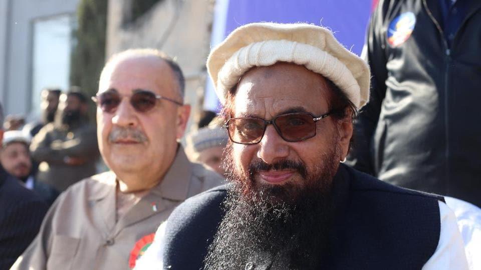 Palestinian ambassador Waleed Abu Ali sits along with Lashkar-e-Taiba founder Hafiz Saeed at a rally in Rawalpindi in Pakistan.
