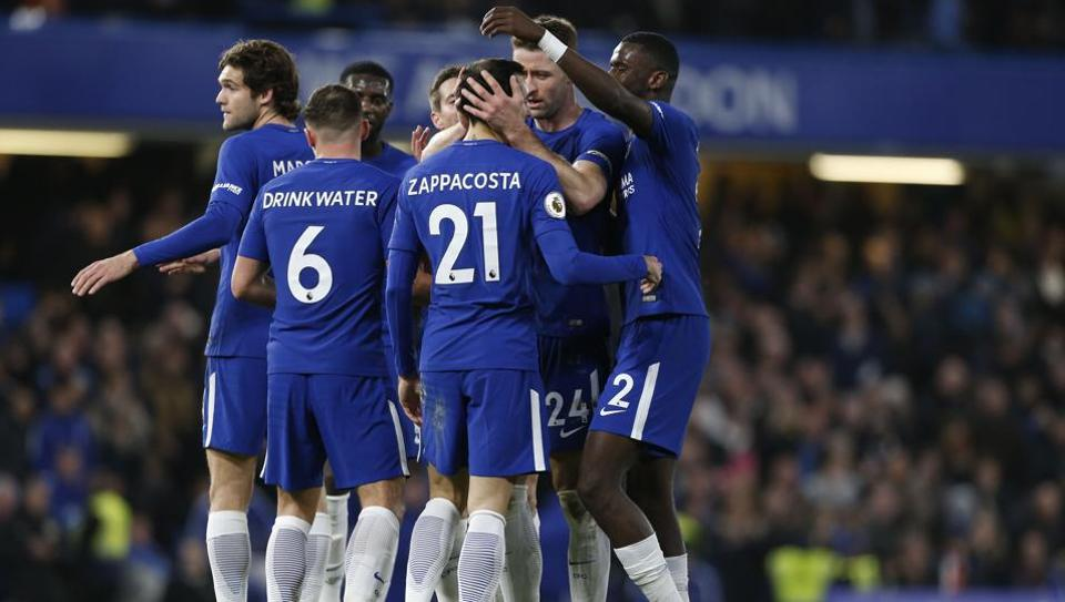 Chelsea's Davide Zappacosta (C) celebrates with teammates after scoring their fifth goal during the English Premier League match between Chelsea and Stoke City at Stamford Bridge in London on December 30, 2017. Chelsea won the game 5-0.
