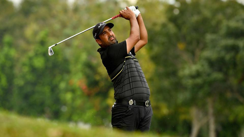 Shiv Kapur of India plays a shot during round three of the Royal Cup golf tournament at the Phoenix Gold Golf and Country Club in Pattaya. Kapur turned in a three-under 68 to hung in right behind the leader Prom Meesawat.
