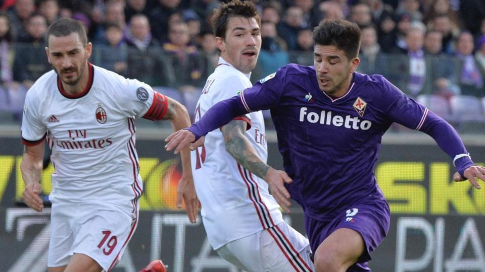 Fiorentina's Giovanni Simeone (R) Milan's Alessio Romagnoli (C) and Milan's Leonardo Bonucci (L) for the ball during the Italian Serie A match between Fiorentina and AC Milan at the Artemio Franchi stadium in Florence on Saturday. The game ended 1-1.