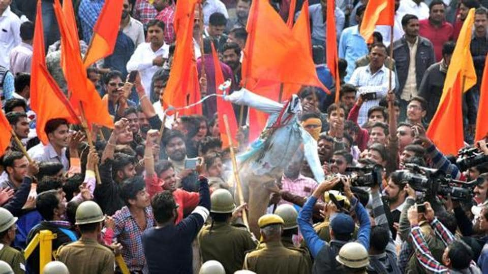 People burn effigies during a protest against film maker Sanjay Bhansali's upcoming movie Padmavati in Rajasthan's Bikaner.