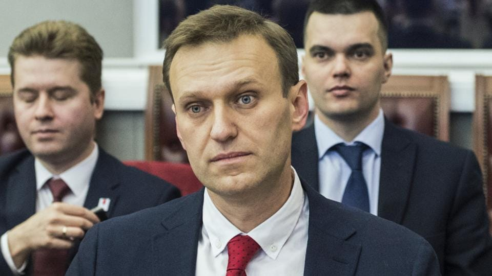 Russian opposition leader Alexei Navalny, who submitted endorsement papers necessary for his registration as a presidential candidate, sits at the Russia's Central Election commission in Moscow on December 25.