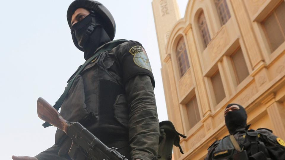 Security forces stand guard at the site of attack on Mar Mina church in Helwan district on the outskirts of Cairo, Egypt.