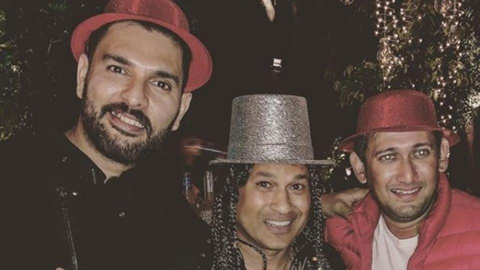 Sachin Tendulkar (C) partied alongside Yuvraj Singh (L) and Ajit Agarkar (R) in the run-up to the New Year.