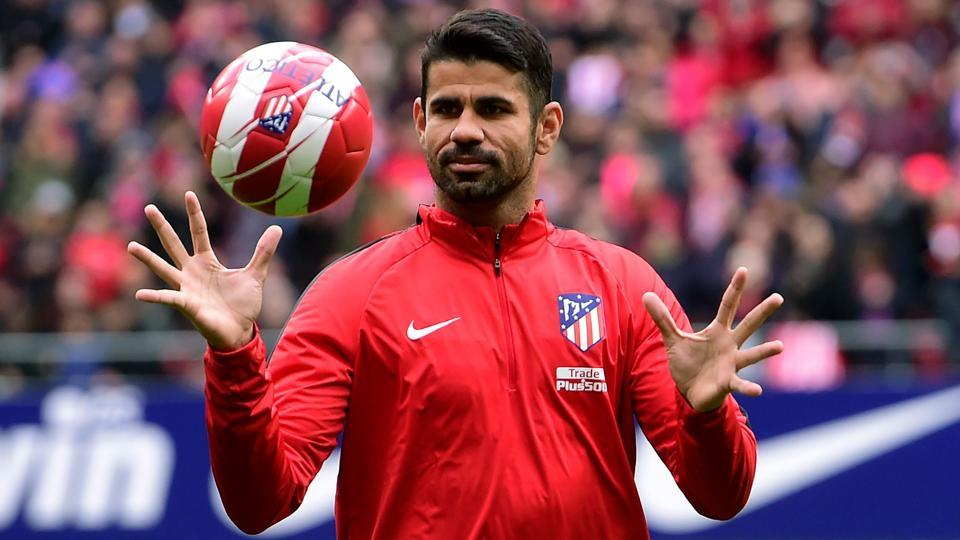 Atletico Madrid's Diego Costa catches a ball at the start of a training session following his welcoming ceremony at the Wanda Metropolitan Stadium in Madrid on Sunday.