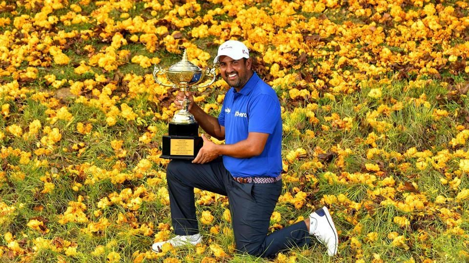 Shiv Kapur poses with the winner's trophy after his victory at the Royal Cup golf tournament at the Phoenix Gold Golf and Country Club in Pattaya.