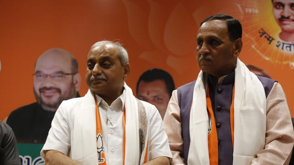 BJP leaders Vijay Rupani (right) and Nitin Patel stand as their names are declared for the post of chief minister and deputy chief minister of Gujarat state after a meeting in Gandhinagar, Dec 22, 2017.